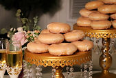 donuts on gold cake stand weddig desserts