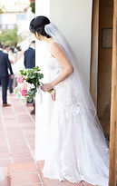 bride looking around corner mexican wedding
