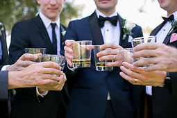 gentlemen drinking whiskey wedding toast