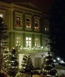 The Villa lit up at night.