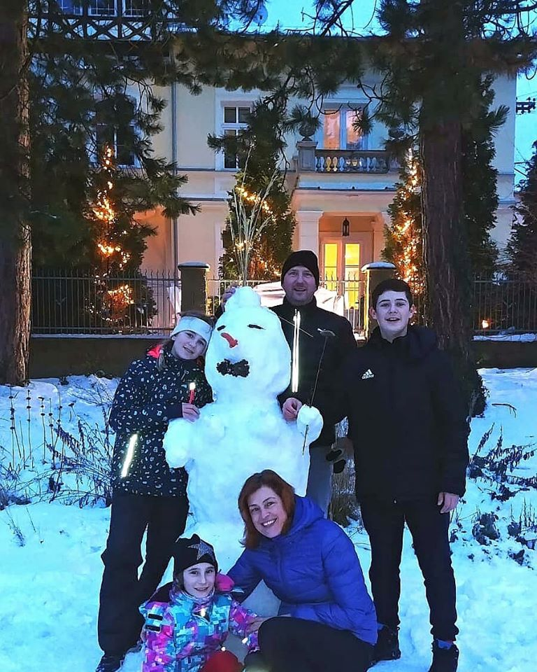 Guests in the snow outside Spa Villa Residence.