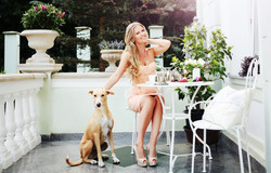 Model with rescue dog on the terrace