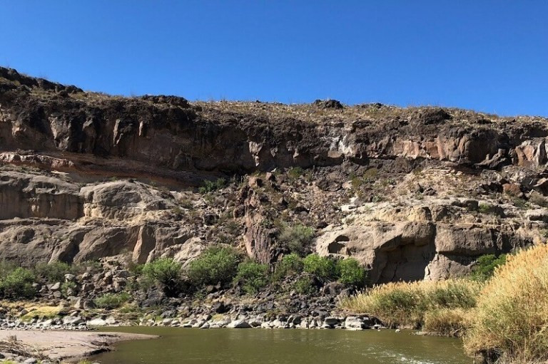 River, rocks and sky in West Texas by Jade Nelson