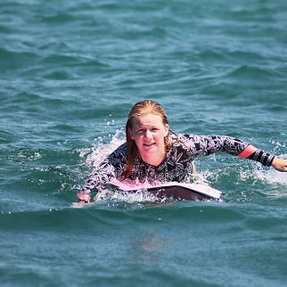 Frankie wearing her 'game face' as she paddles back to the line-up after catching a wave.