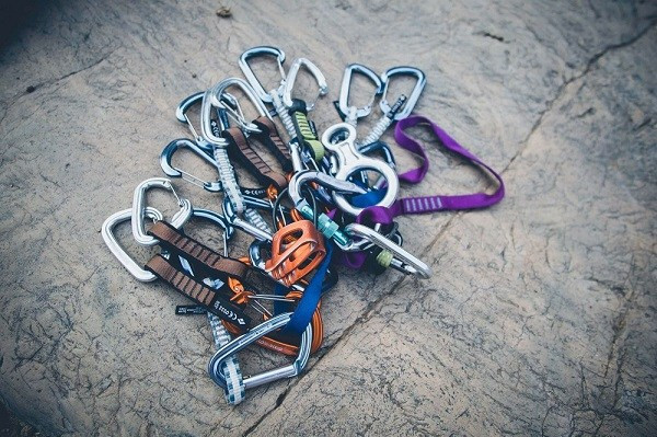 cams and gears for climbing - cameron-kirby via unsplash