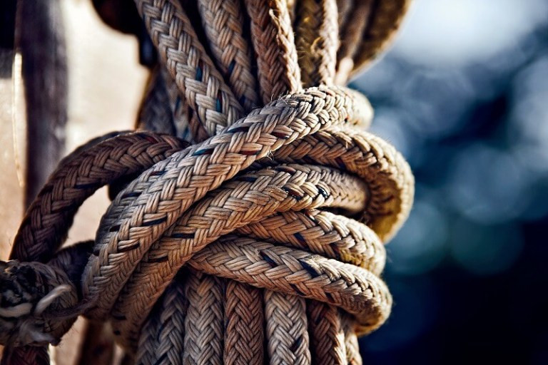 Climbing rope coiled ready for adventure - robert-zunikoff via unsplash