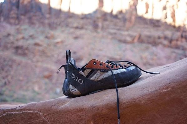 climbing shoe on orange rock cindy-chen-via unsplash