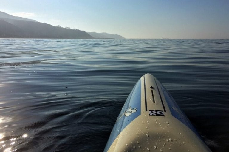 View of mother ocean over the tip of the paddleboard by Jared Muscat