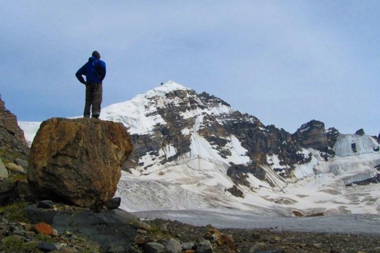 Man on rock Staring at the Himalayas