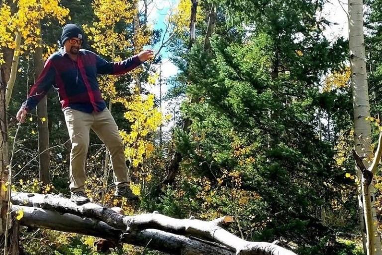 American Ninja Warrior balancing on log in Boulder Colorado