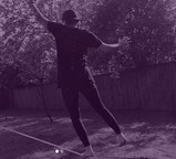 Cath balancing on a slackline. There is a purple filter over the picture.