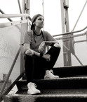 Cath sitting on metal steps looking thoughtful
