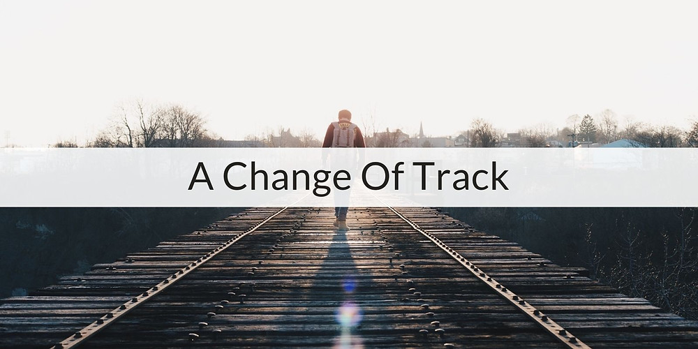 A picture of a person walking down some train tracks. Over the top is the episode title 'A Change of Track'.