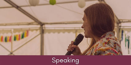 Fran speaking into a microphone linking