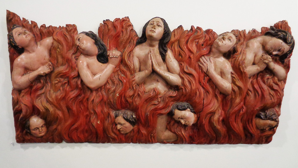 Anima Sola wood carving with gesso and oil paint, depicting the souls suffering in Purgatory.
