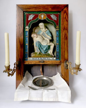Altar with pieta set up with cloth, candles, platen and spoon