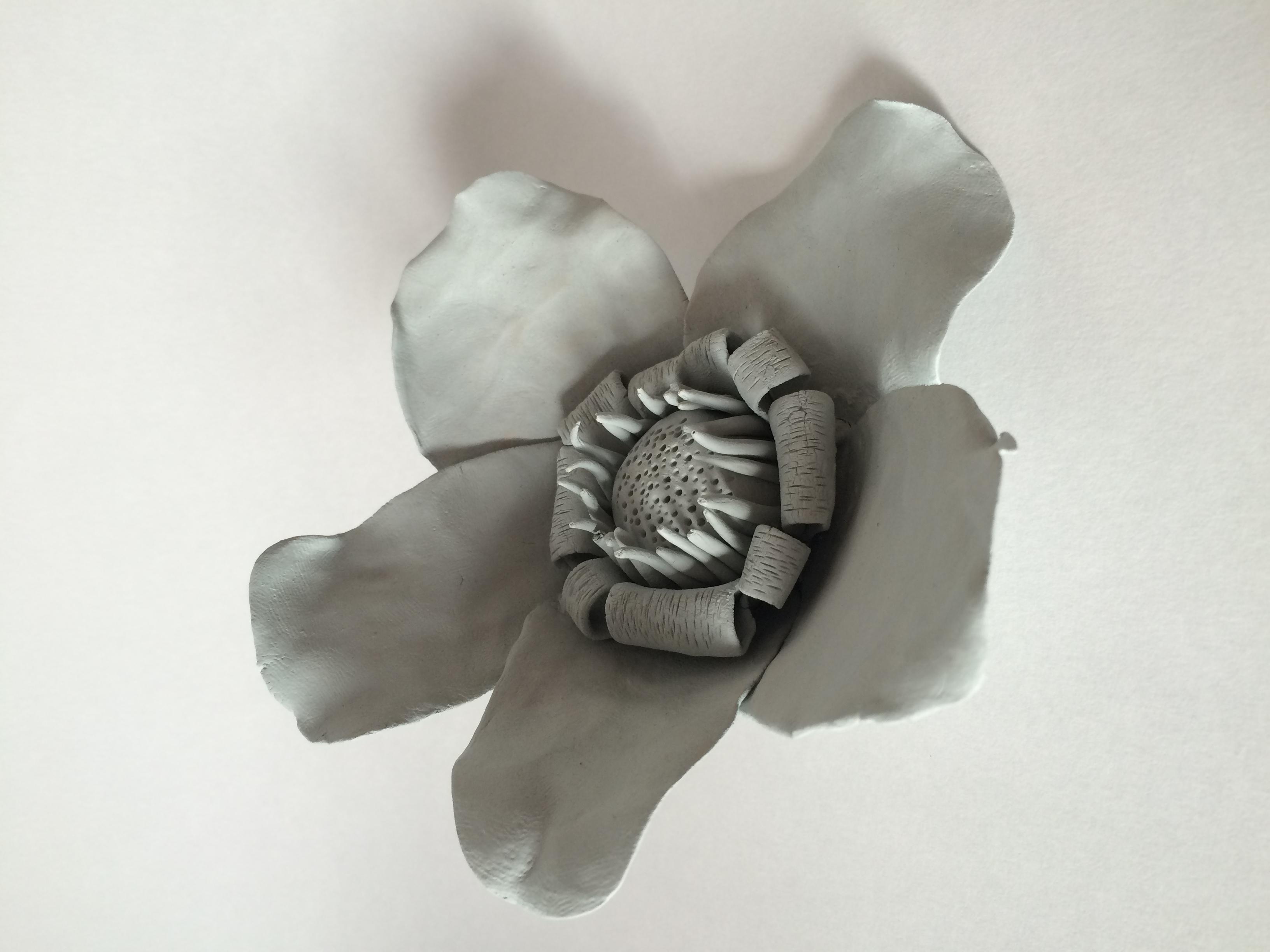 Fleur . Faïence bleue
