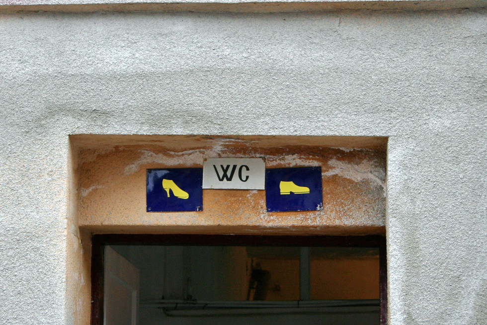 Female and male signs for restrooms