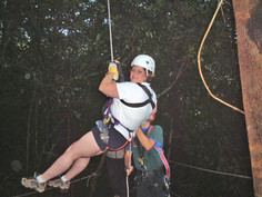 Ria rappeling from the treetops