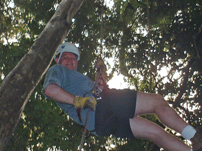 Gavin rappelling from the treetops