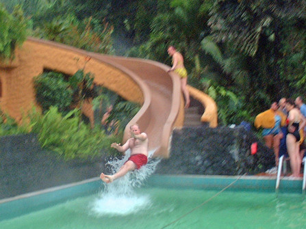 Gavin sliding into one of the pools at Tabacon Hot Springs