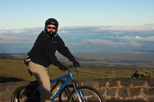 Biking down Mt. Haleakala volcano, Maui