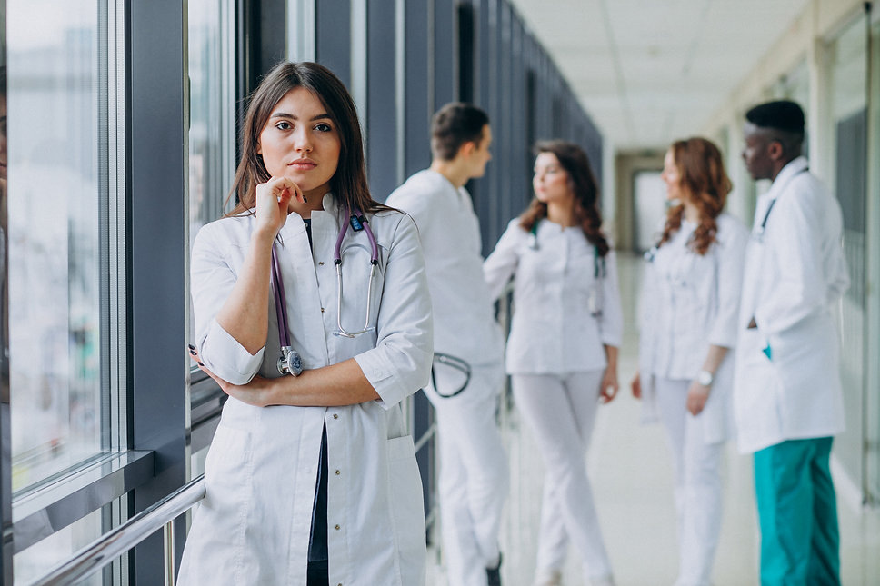 young-female-doctor-posing-in-the-corrid