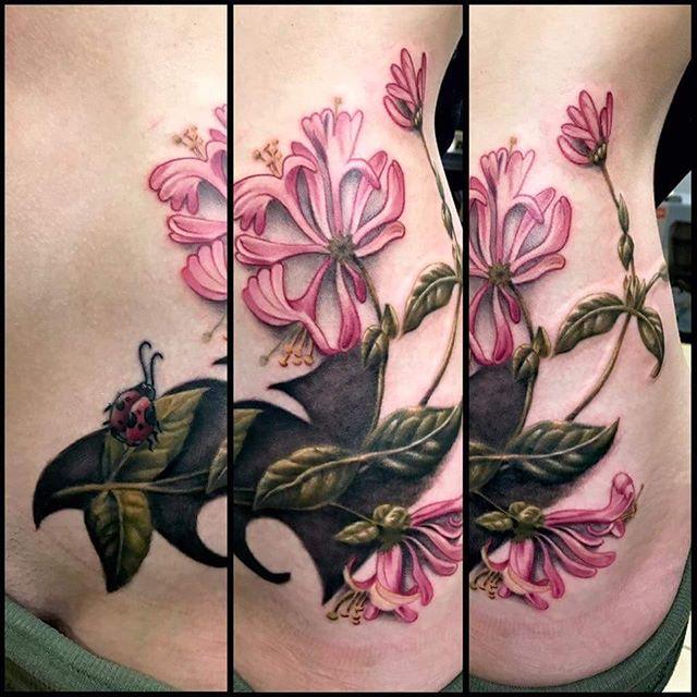 Such beauty by Shawn Elliott _shawn_elliott_isa!!! #tattoos #honeysuckle #flowertattoo #ladybug #hip