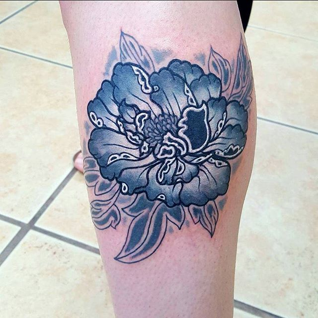 This unique peony was done on our tattoo artist, Jordan Haines _jordanhainestattoo, by fellow artist