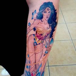 This Wonder Woman was done by Joshua Kunkel _jfdk23! #tattoo #tattooinspiration #tattooideas #cartoo