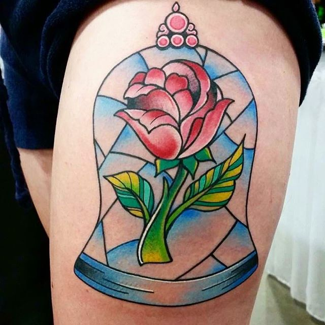 Beauty and the Beast stained glass rose done by _thomassandstattoo #intenzetattooink #redemptiontatt