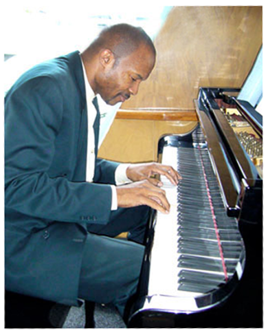 GB-at-piano-on-yacht-1.png