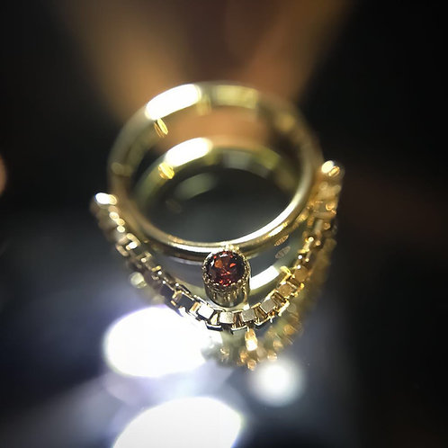 Ring with chain and ruby