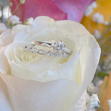 Diamond Solitaire with vintage style wedding band.