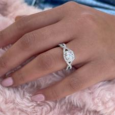 Cushion shaped Halo style Engagement Ring