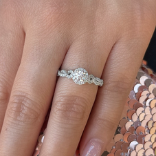 Halo style Engagement ring with a delicate Infiity style band. This ring is set with one of our hand picked Endess Fire