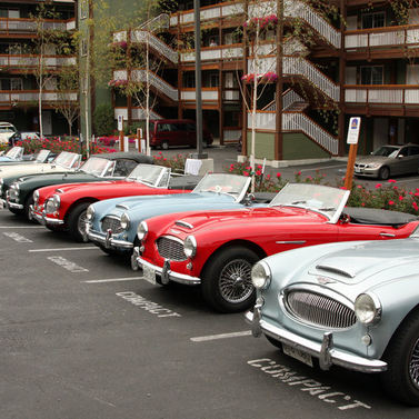 Healey from Cascade, Oregon, and B.C. AHC's. Cars are parked in the hotel lot at Chelan, WA at the NW Meet.