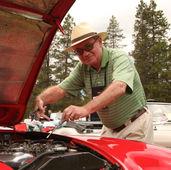 "AHCO President Jerry Alderman (aka ""The Mechanic"") adjusting John Carter's Webers"