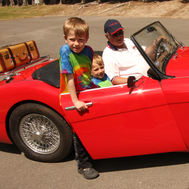 George Koeber giving a couple kids their first sports car ride.