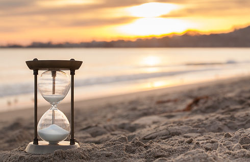 Hourglass in the dawn time. Sand passing