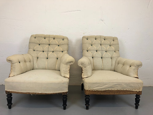 Pair of deep buttoned armchairs (upholstery inclusive)