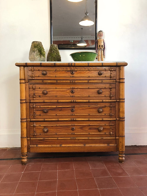 A faux bamboo chest of drawers