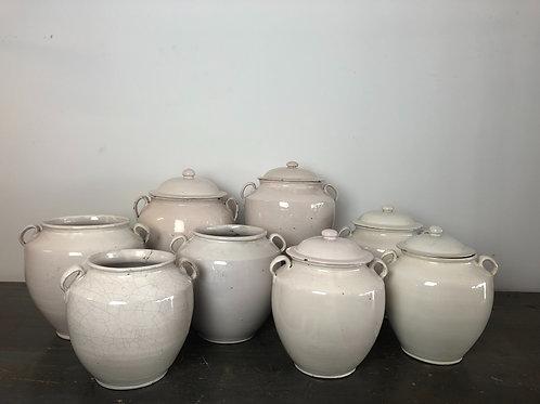 Collection of 9 antique white confit pots