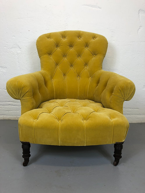 Antique deep buttoned french armchair