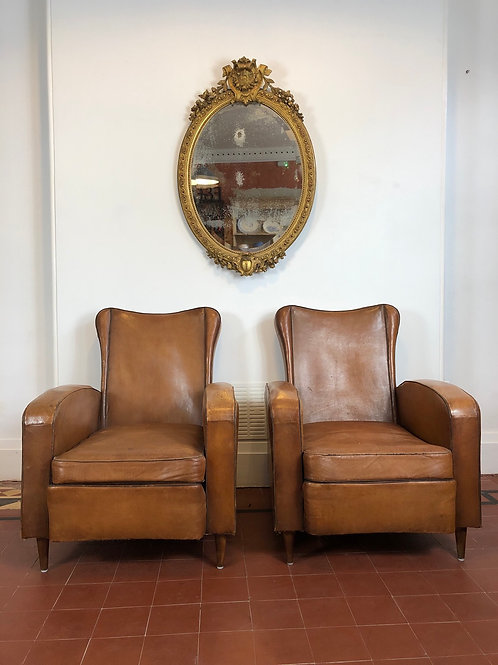 Pair of 1940's leather armchairs