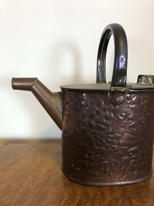 A charming copper watering can