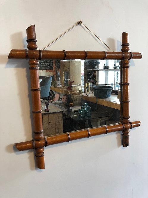 A faux bamboo mirror