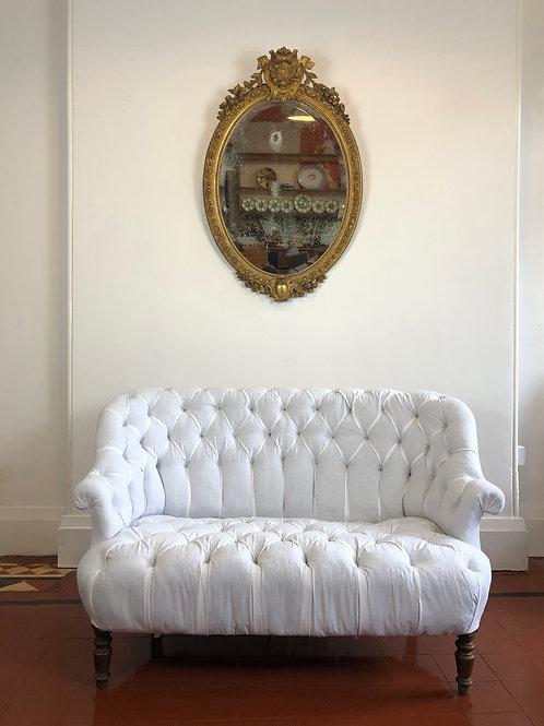 Antique deep buttoned calico sofa