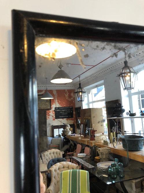 A ebonised shop mirror