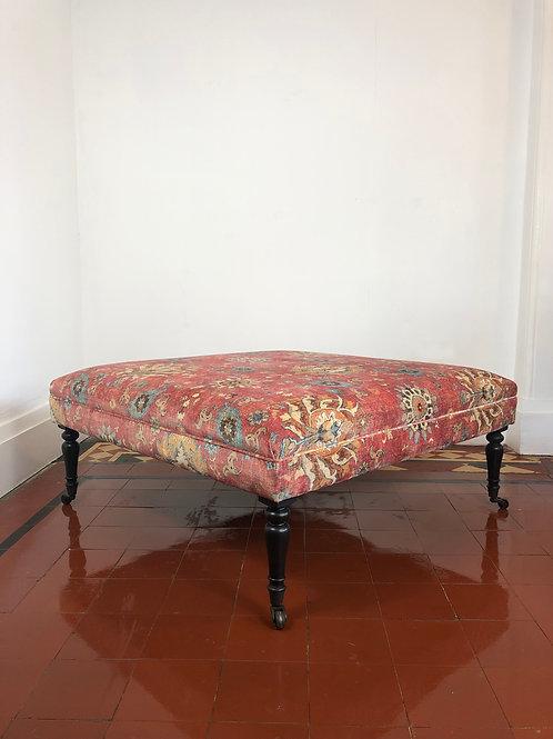 A Handmade upholstered footstool
